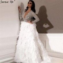 فساتين سهرة فاخرة بأكمام طويلة باللون الأبيض من Dubai 2020 فستان سهرة مثير بياقة على شكل حرف v مزين بالترتر ماركة Serene Hill LA6574