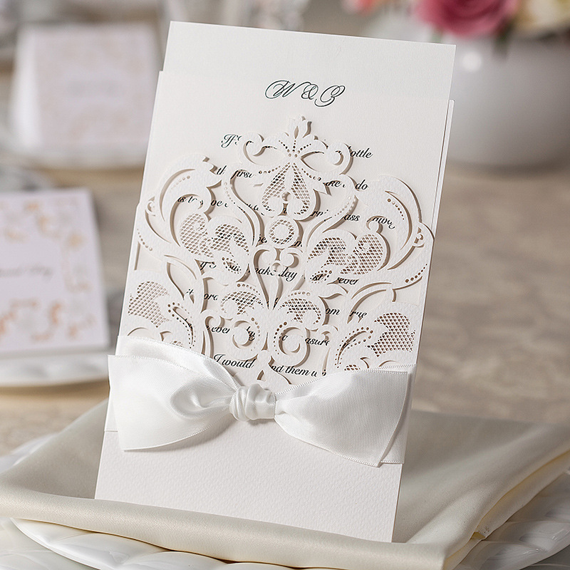 Free shipping 50pcslot white elegant bow laser cut wedding free shipping 50pcslot white elegant bow laser cut wedding invitations card wedding supplies in cards invitations from home garden on aliexpress stopboris Images