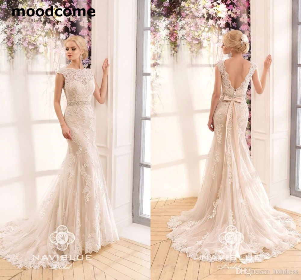 2018 New Gorgeous Lace Mermaid Wedding Dresses Naviblue Bateau Neck Cap Sleeves Backless Beaded Ribbon Vintage Bridal Gowns