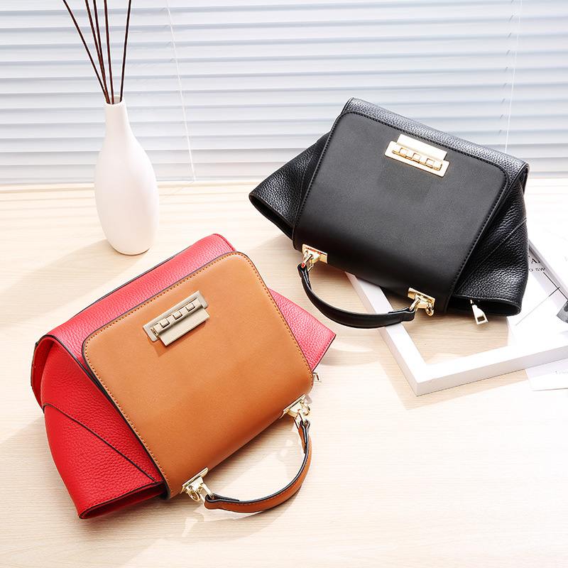The new Europe big Leather Handbag Shoulder Messenger Bag wings stitching head layer cowhide swing portable bag europe and the new spring and summer leather handbag bag simple cross head layer cowhide temperament mini bag tote bag