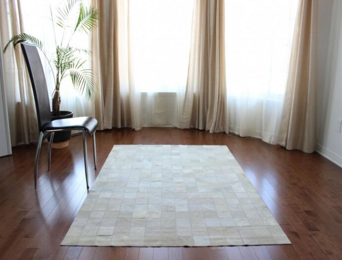Patchwork cowhide pure white with squares in carpet from home