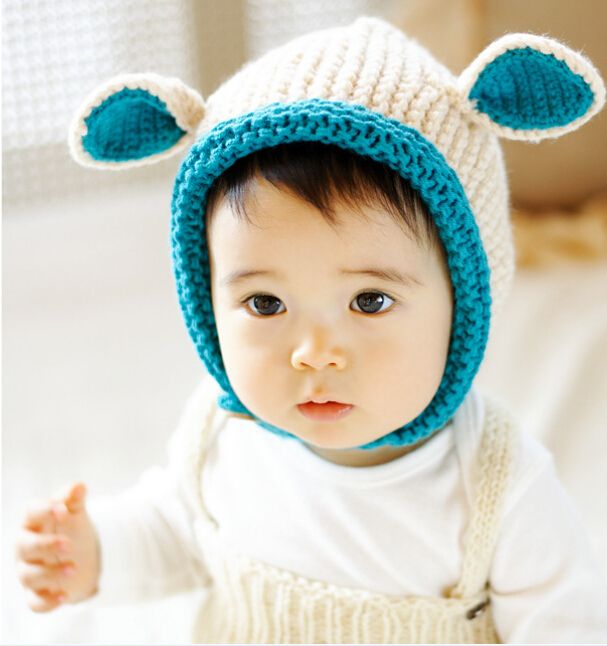 b0a1e94559e 2015 Autumn Korean Thick Knitted Hats Winter Hats Baby Beanies Skullies  Child Woolen Caps handmade Two Ear Cute Baby Hats-in Hats   Caps from Mother    Kids ...