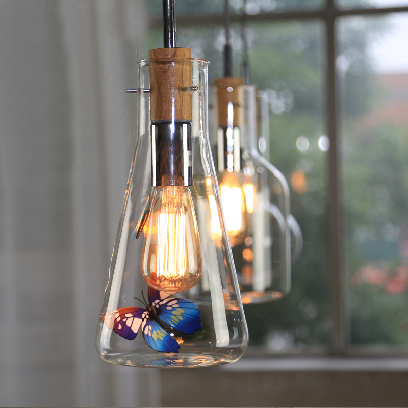 Nordic style transparent glass bottle chandelier Simple Art Cafe balcony bar single head windows small hanging lamp vintage clothing store personalized art chandelier chandelier edison the heavenly maids scatter blossoms tiny cages