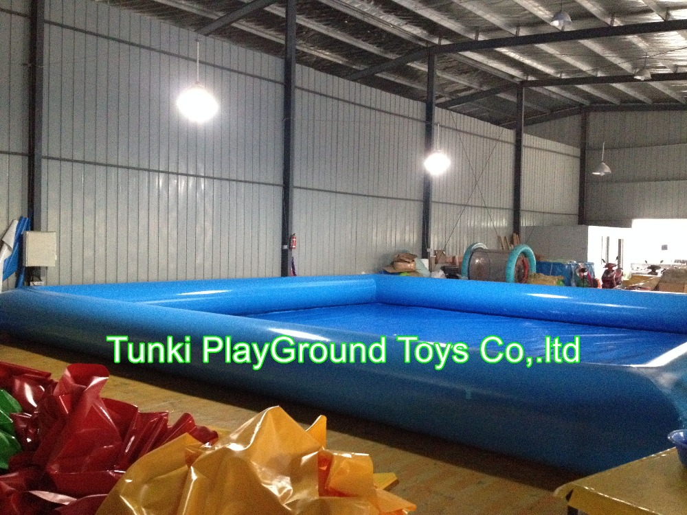 blue paddling pool inflatable baby swimming sand ocean ball