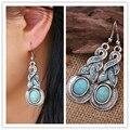 2017 Encanto diseño único pendiente de plata tibetano con turquesa y joyas de cristal azul pendientes de aro para las mujeres de la vendimia Caliente