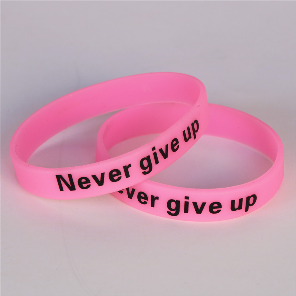 Купить с кэшбэком LUKENI 1PC Never Give Up Luminous Silicone Wristbands Pink  Motivational Hologram Sport Bracelets& Bangles Cuff Gift SH095PI