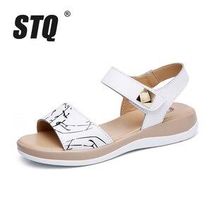 Image 2 - STQ 2020 kadın sandalet yaz hakiki deri düz sandalet ayak bileği kayışı düz sandalet bayanlar beyaz Peep Toe flip flop ayakkabı 1803