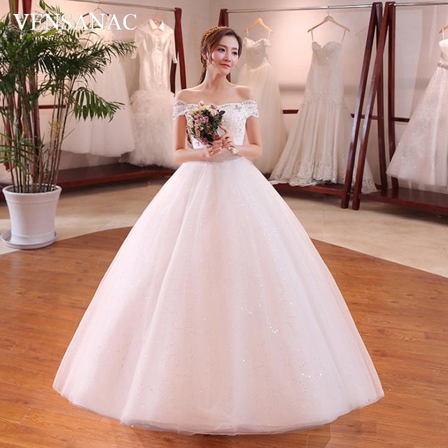 Us 57 85 35 Off Vensanac 2018 Crystal Boat Neck Sequined Ball Gown Wedding Dresses Lace Embroidery Short Sleeve Backless Bridal Dress In Wedding