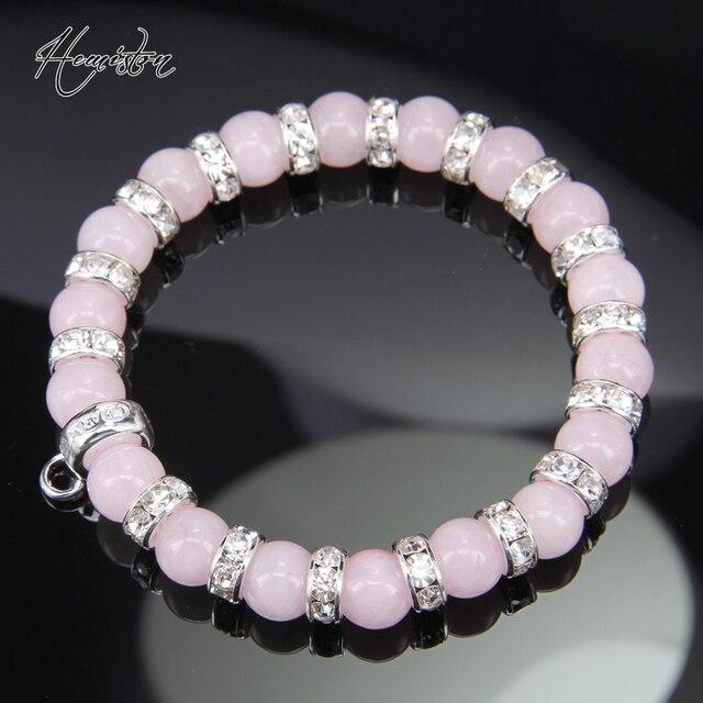 Фото розовый браслет из бисера в стиле томаса с фирменной подвеской