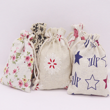 2019 new 50 pcs best selling fashion cotton linen fabric dust candy/gift/party/school bag home Sundry kids toy storage bags