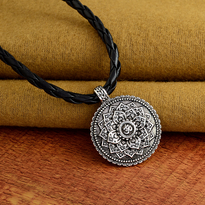Ohm Pendant Necklace on yoga mat covers