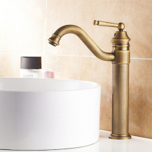 цена на Antique Brass Swivel Spout Single Hole Basin Faucet Deck Mounted Vanity Sink Mixer Tap KD718