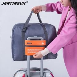 Fashion waterproof travel bag large capacity luggage pouch women nylon foldable travel tote unisex portable bag.jpg 250x250