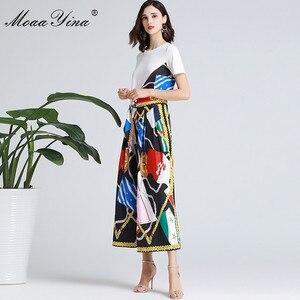 Image 1 - MoaaYina ensemble de créateurs de mode printemps été femmes à manches courtes ruban T shirt + rayure imprimé large jambe cloche bas costume deux pièces