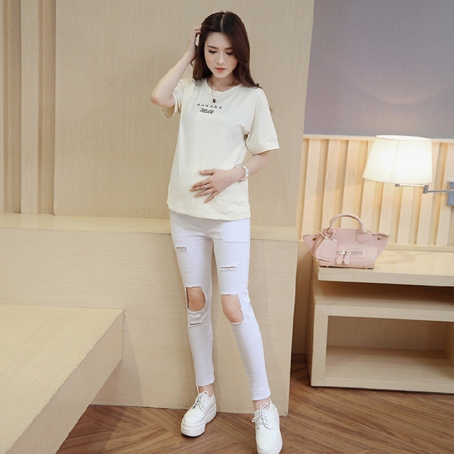 Maternity Korean version of the 2016 white knee frayed black hole nine points jeans feet pencil pants tide