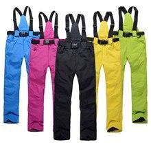 Новые спортивные высококачественные женские лыжные штаны на подтяжках, мужские ветрозащитные водонепроницаемые теплые цветные зимние сноубордические брюки