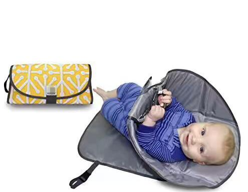 Portable Clean Hands Changing Pad. 3 in 1 Diaper Clutch, Changing Station, and Diaper-Time Playmat With Redirection Bag