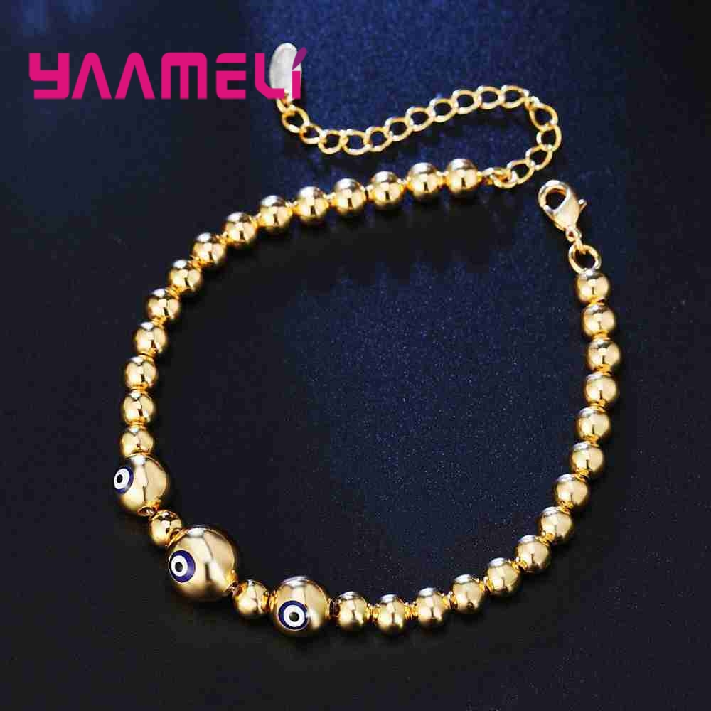 Silver Bangle with Gold Color Beads