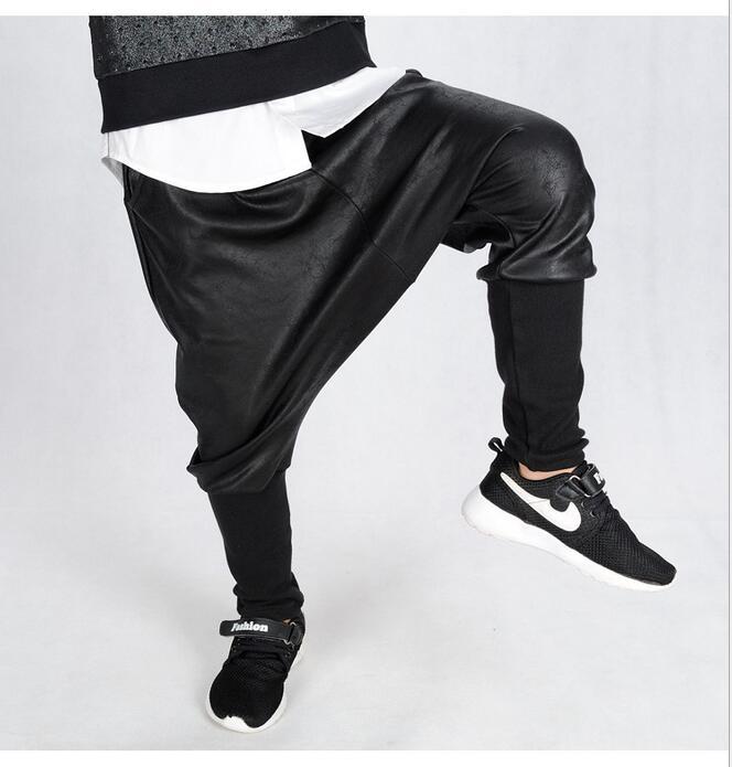 Neue Heiße Verkauf Unisex Niedrig Getäfelten 2019 Mode Kunstleder Pluderhosen kinder Drop Crotch Baggy Casual Elastische Taille Kreuz