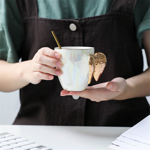 Image 5 - Creativo Bianco Tazza In Ceramica Placcato Oro Maniglia Ali di Angelo Home Office di Caffè Latte Tazze di Porcellana Coppia Regalo Della Decorazione Della Casa