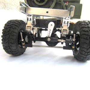 Image 4 - Do WPL B1 B 1 B14 B 14 B16 B 16 B24 B 24 C14 C 14 B36 MN Model D90 D91 części do ulepszenia samochodów zdalnie sterowanych zaktualizowane steru metalowe mocowanie płyta