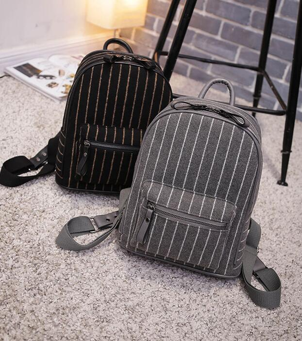 The new female backpack trend striped woolen material quality ladies leisure backpack free shipping high grade