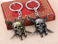 Pirates of the Caribbean keychain Captain Jack Sparrow mask Skull and Crossbones Keyring keychain for fans AD