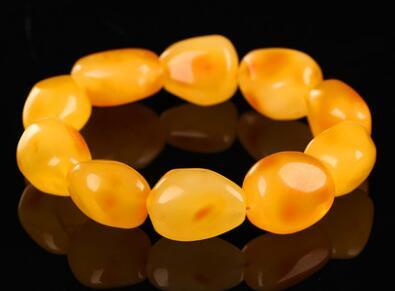 Hagit-Ambre huile de poulet jaune cire main chaîne hommes et femmes de naturel pur qualité pierre bracelet.