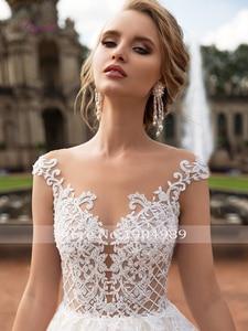 Image 4 - Liyuke תחרה אונליין חתונה שמלות אפליקציות סקופ צוואר שרוולים גב פתוח סקסי אשליה טול קפלת רכבת Vestido דה novia