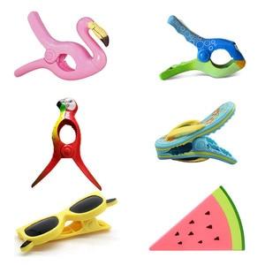 Image 1 - Mocne plastikowe klipsy kolor typ zwierząt ręcznik plażowy zacisk, aby zapobiec wiatr zacisk ubrania kołki stojaki do suszenia klip mocujący
