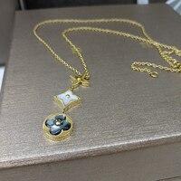 Bijoux en gros de trois à quatre feuilles blanc coquille de camélia avec collier Pendentif électrolytique rose bijoux en or.