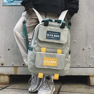 Image 1 - Dcimor新しい大容量のバックパック防水ナイロンリングポータブルバックパックスクールバッグ十代の少女mochila女性デイパック