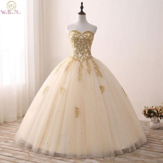 7d096fc5f Vestidos de quinceañera dorados con Apliques De encaje Vestido de bola con  cuentas Vestidos sin tirantes
