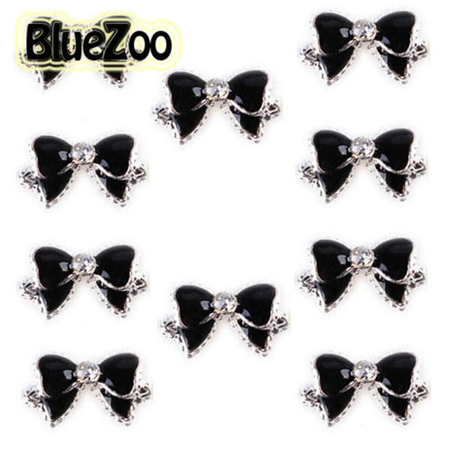 BlueZoo 100 unids/pack Negro 3d Aleación Pajarita Rhinestones Del Arte Del Clavo Decoración de uñas Glitters Rebanadas DIY Del Perno Prisionero Del Clavo Extremidades Envío Gratis