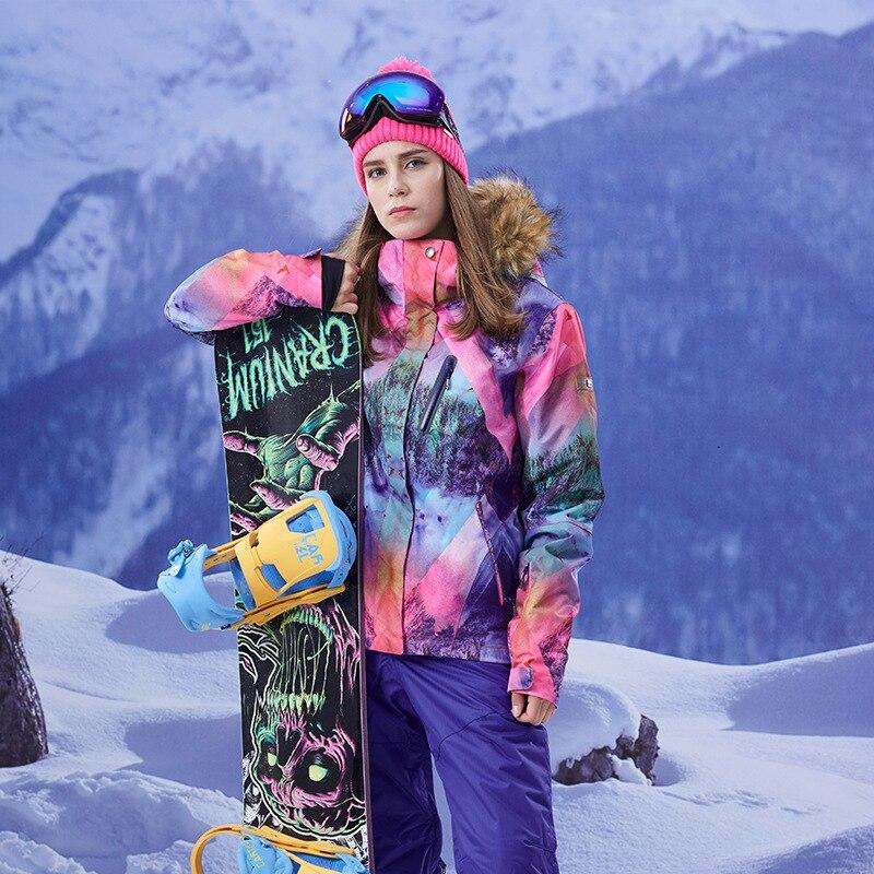 GSOU NEIGE Ski Veste Femmes de Snowboard Veste Fuir À Capuchon D'hiver de Ski Imperméable À L'eau En Plein Air Dames Sport coupe-vent Vêtements manteau