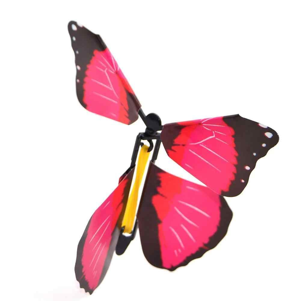 10 pc Voando Borboleta New Exóticos Engraçado Surpresa No Sentido Horário de Rotação de Plástico Borboleta Voando Truques de Mágica de Brinquedos Do Bebê Cor Aleatória