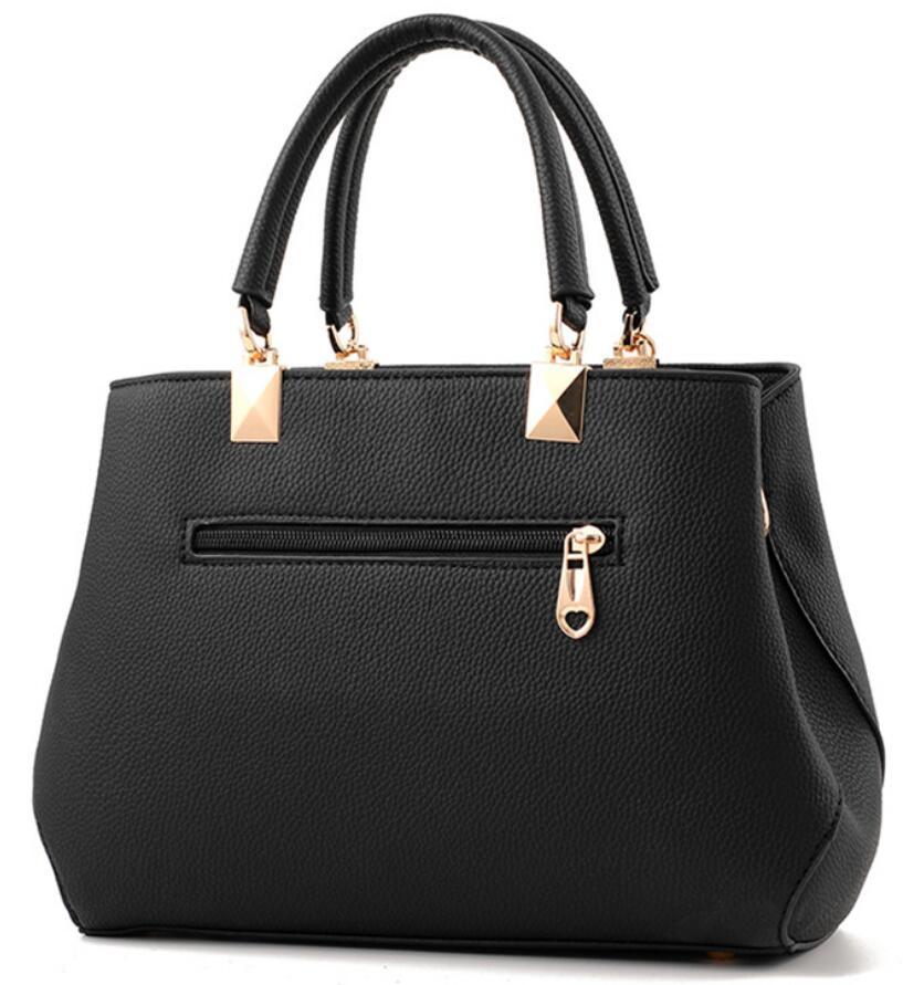 kvinnor hårdvara ornament solida väskor handväska hög kvalitet - Handväskor - Foto 2