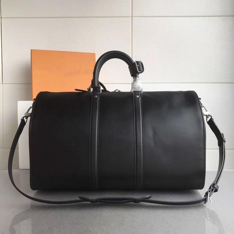 Véritable cuir de luxe hommes femmes sac de voyage Designer 50 cm haute qualité aéroport sacs à main voyage sacs sac à bandoulière pour hommes Duffle