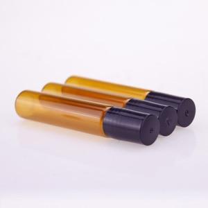 Image 4 - 50 Stks/partij 10Ml Roll Op Draagbare Amber Glazen Navulbare Parfumfles Lege Etherische Olie Case Met Plastic Cap
