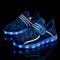 Nueva moda light up kids shoes luminoso led niños niñas zapatillas de deporte de color brillante ocasional con cargo exclusivo de simulación para los niños