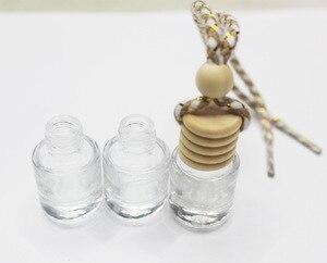 Image 1 - FM887 5ML Kleine Transparent Zylinder Gold Samt Seil Hohe Durchlässigkeit Glas Parfüm Anhänger Leere Flasche 100 PCS/LOT