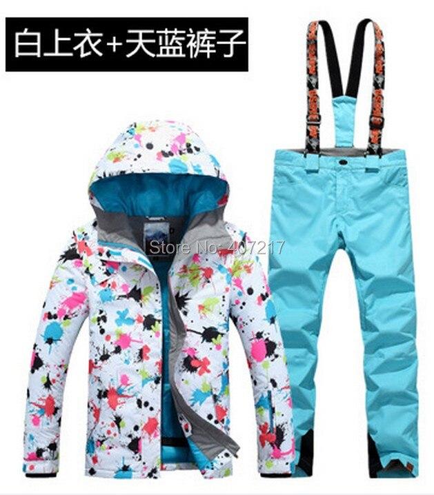Prix pour 2017 New hot femmes de combinaison de ski féminin jeu de snowboard femmes vêtements de ski coloré fleur impression veste de ski et bleu clair bib pantalon