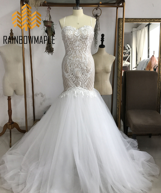 ecfa17d5a67c Unique Lace Mermaid Wedding Dresses For Bride Sexy Backless Spaghetti  Straps Court Train Wedding Dress Champagne Bridal Gowns