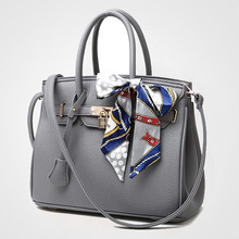 2016 Spring Xia Xinkuan European Woman Package Litchi Grain Platinum Package Single Shoulder Portable Woman Bag