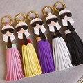 9 color karlito famosa Marca de Lujo Hecho A Mano Lindo borlas de Piel Llavero Llavero de Cuero Genuino de Las Mujeres Bolsa Colgante Encanto para clave