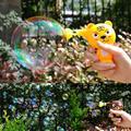 Crianças dos desenhos animados modelo animal brinquedo bubble gun ventilador ao ar livre de água e sabão presente