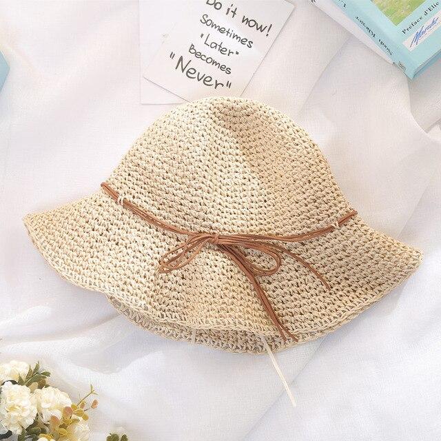 c75f3f1c2ae 2017 Summer Women Floppy Hollow Breath Straw Bucket Hat With String Bow  Wide Floppy Brim Fishing Hats Beach Sun Protection Caps