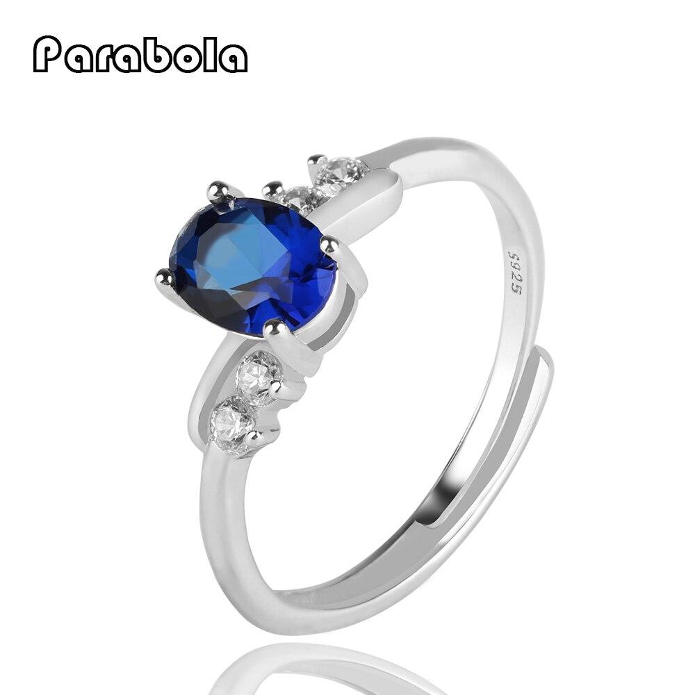обручальные кольца синий камень