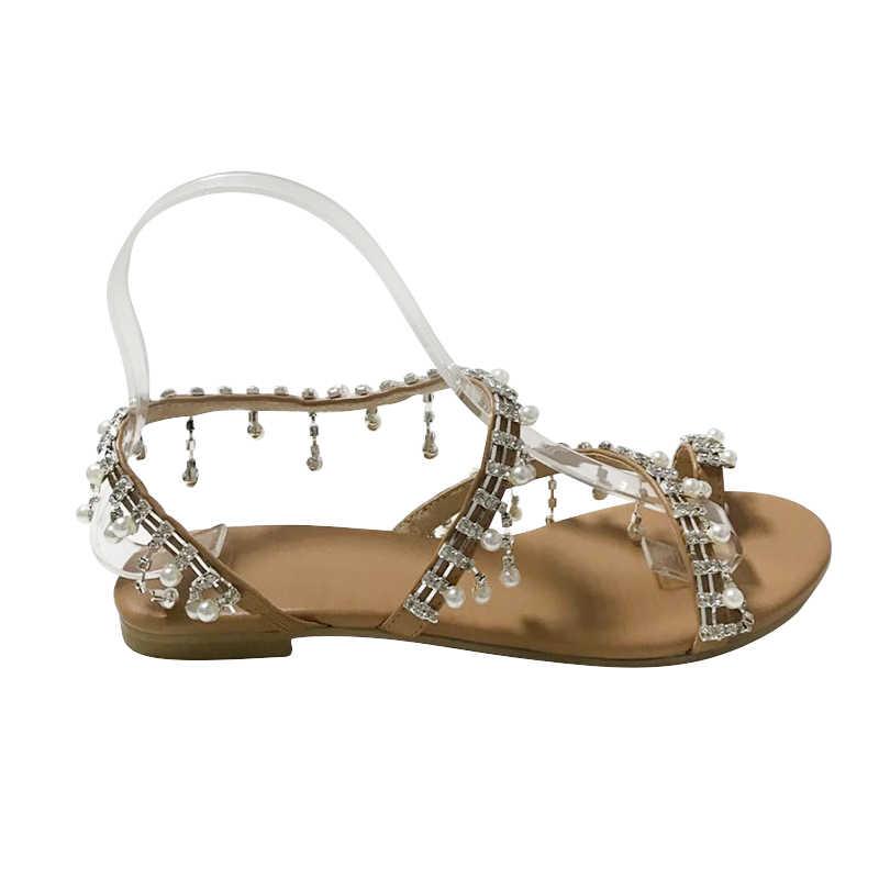Римские сандалии для женские большие размеры жемчуг Sandalias плоским Кристалл ремешками крест галстук с кольцом Женская летняя обувь роскошные Тапочки