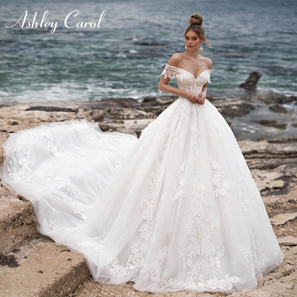 Ashley Carol Sexy Sweetheart Wedding Dress 2020 Shining Beach Bride Dress Cap Sleeve Backless Appliques Cathedral Wedding Gowns